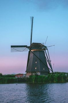 Beautiful Dutch windmill at sunset with blue and pink hues in background. See the beautiful windmills at Kinderdijk in the Netherlands! Holland Cities, Visit Holland, Netherlands Windmills, Holland Netherlands, Holland Strand, Holland Beach, Sustainable Tourism, Travel Oklahoma, Dutch Windmill