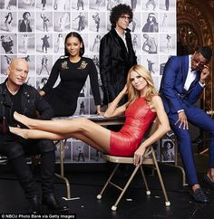Baby, I'm the star: Heidi Klum made herself the center of attention in a red dress as her ...