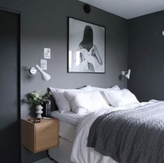 Love the dark grey wall used in this bedroom bed Pinterest