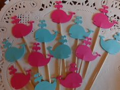 "Whale Cupcake Toppers - Bright Pink and Aqua Blue - Party Picks - Pink and Blue Whales Food Picks - Baby Shower Appetizer Picks (Set of 24). 24 Whale Cupcake toppers / food picks Perfect for your baby shower or nautical party! amount: 24 picks size: approx. 3"" tall and Whales are 1"" each Double sided - like all of my food picks ~ so they look great from all sides! ~~ Colors may vary slightly on computer screen. ~~ The key to a great party is in the details! These cute cupcake toppers…"