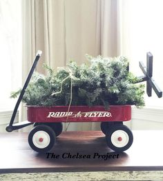 I was looking for a unique Christmas decoration for my coffee table.  At the same time, I ran across this Radio Flyer in the basement that didn't have a holiday…