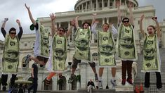 8 Things You Can Do to Help Get Money Out of Politics Represent.Us's dollar bill costumes worn during the K Street 5K. (credit: Represent.Us)