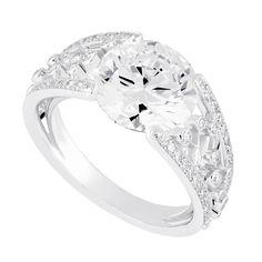 FRED NUIT  ring in white gold and diamonds. 107 brilliant cut diamonds: 0,56 carat GVS. Center stone : brilliant cut diamond, 4,22 carats EIF.