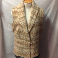 """Heavy weight Ralph Lauren sweater vest. Size XL Shades of cream and tan, LAUREN by Ralph Lauren sweater vest. Knitted made of lambda wool, angora, silk. Horn toggle button to close. Size XL. Very good pre-owned condition. Approx. 26"""" in length., 24"""" from armpit to armpit. Armholes approx. 24"""" in diameter. This would fit about a 14/16 in my opinion. Ralph Lauren Sweaters"""