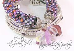 Tanya Lochridge Jewelry Vintage Hearts Stackable Bangle stacked here with a Judith Ripka amethyst bangle. #judithripka #tanyalochridgejewelry