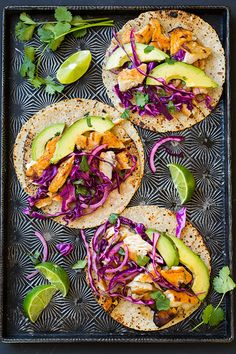 Grilled Fish Tacos With Cabbage Slaw and Avocado: Dress up tilapia fillets with a quick trip to the grill and irresistible taco toppings including avocado and red-cabbage slaw.