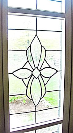 DIY Beveled Glass Front Door Sidelights - simply draw on glass using a product called Gallery Glass to create a beveled look - pattern and instructions included. This would work on any glass if you're not wanting to make sidelights.