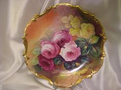 """Stunning 15 3/4"""" Antique Hand Painted Limoges Wall Plaque Charger ~ Breathtaking ROSES ~ Museum Quality Masterpiece Still Life Painting One-of-a-Kind Floral French Painting on Porcelain w Elegant Rococo Border ~ Artist Signed """"Bronssillon"""""""