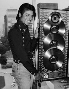 Michael Jackson with his platinum Thriller awards