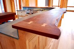 This walnut live-edge countertop features butterfly joints crafted of Butternut which match the custom cabinetry.