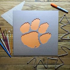 Shorten painting time with Stencil Stop's Clemson University Tiger Paw logo stencil. Made from sturdy corrugated paper, this stencil can be used to transpose Clemson's logo onto the surface Clemson Logo, Clemson Tiger Paw, Clemson Football, College Football, Decoupage, Creative Thinking, Crafty, Yeti Cooler, Cnc Plasma