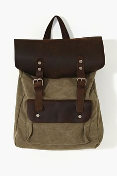 Backpacks are the shit for the SS13 season. This is a hit for two reasons: 1) cool dark-brown leather details, and 2) the olive green color - the it-color of 2013.