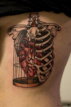 Creative Heart in Cage Tattoo
