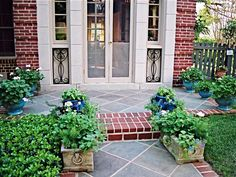 Incorporate containers in your front yard landscape so you can easily change your plants as the seasons progress. Buy seasonal plants when the time comes and enjoy them without having to plant months in advance. Design by Virginia Rockwell