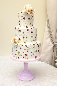 Tiered painted roses cake