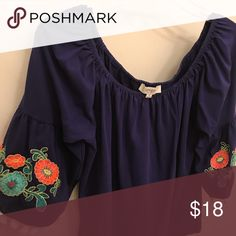 Umgee top Umgee top with embroidered bell sleeves. Can be worn off the shoulder or on. Great condition, smoke free home. Umgee Tops