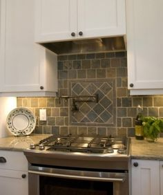 Hemingway's Cottage - Eclectic - Kitchen - raleigh - by Blue Sky Building Company Natural Stone Backsplash, Backsplash With Dark Cabinets, Backsplash Cheap, Stainless Backsplash, Travertine Backsplash, Beadboard Backsplash, Herringbone Backsplash, Kitchen Backsplash, Hexagon Backsplash