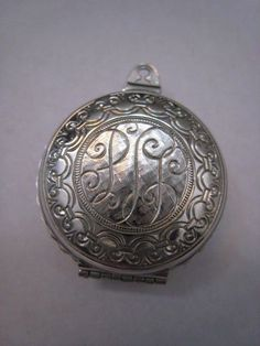 Large 1950s Vintage Silver Locket Pendant With by Glamaroni, $15.00