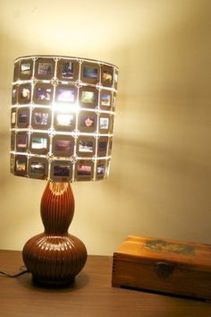 Film Lamp Shade... @Julie Forrest Basello-Holt no tutorial but this would be easy enough w/ the right shade and jump rings