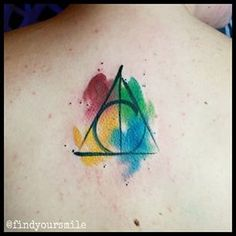 the deathly hallows symbol, with paint style house colors