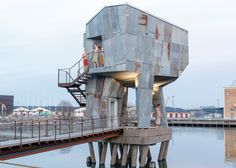 This sauna by Raumlabor is set above the waters of a Gothenburg port in Sweden and features a rusty steel exterior and a warm timber-lined interior