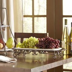 Birch Lane Marble Server Display snacks on this charming server, featuring a cream-colored marble platter and a scrolling brown metal stand. Kitchen Display, Food Trays, Birch Lane, Serving Plates, Serveware, Bath And Body Works, Home Projects, Home Remodeling, Table Settings