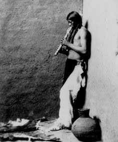American Indian Playing an Instrument
