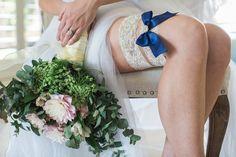 Audrey ivory lace rhinestone garter set with navy blue toss garter. Only $28.89 at Ella Winston Co https://www.ellawinston.com/collections/rhinestone-garters/products/ivory-lace-rhinestone-garter-with-personalized-bow #somethingblue #bridetobe