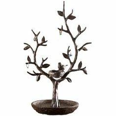 """Bronze-finished jewelry tree with a bird and branch design.   Product: Jewelry treeConstruction Material: MetalColor: BronzeDimensions: 16"""" H x 10"""" W x 7"""" D"""