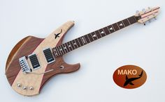 MAKO  Body Black Walnut, with flamed Maple and Purpleheart. Ilay Ebony and MOP. Active Pickups from Langcaster