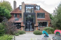 Don't Judge This English Home By Its Traditional Facade - WSJ. The rear of the Shrimplin family home, with its new central window.VANESSA BERBERIAN FOR THE WALL STREET JOURNAL