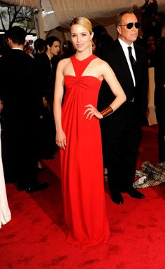 Diana Agron - love the sleek hair, metal cuff and race strap front of the dress