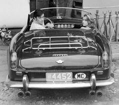 Alain Delon arriving on the Antibes, France set of 1964′s Les Félins with Jane Fonda in a Ferrari 250 GT Spyder California