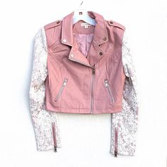 Pink faux leather lace bomber moto jacket ‼️OPEN TO OFFERS‼️ PINK IS NOW AVAILABLE! Comes in black as well! Available in Small, Medium, and Large. back by popular demand! Pink faux leather asymmetrical collar zip bomber moto jacket with off white or Beige floral brocade lace contrast sleeves. Brand new in package. Dusty rose pink faux leather body with off white floral brocade pattern lace contrast sleeves. Bodice is Slightly cropped length. These go FAST! Jackets & Coats