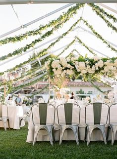 Outdoor wedding decor with cascading garland and florals: http://www.stylemepretty.com/2017/04/07/heading-outdoors-for-a-stunning-black-tie-wedding-al-fresco/ Photography: Erica Schneider - http://ericaschneiderphotography.com/