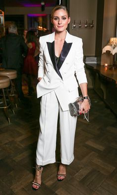 Olivia Palermo in a white smoking suit with cropped pants