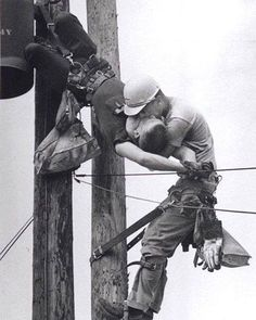 """This 1967 award-winning photo entitled """"Kiss of Life"""" shows two power linemen, Randall Champion and J. D. Thompson, at the top of a utility pole.  Over 4000 volts entered Champion's body and instantly stopped his heart (an electric chair uses about 2000 volts).  Thompson and another worker administered CPR on the ground, and Champion was moderately revived by the time paramedics arrived."""