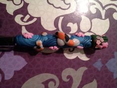 koi fish polymer clay pen. $7.00, via Etsy.