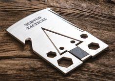 The Survco Tactical Credit Card Ax is the ultimate survival tool, it is able to perform 21 functions and is compact and slim enough to fit in your wallet. The tough multitool won't rust, it is made in 12 gauge, 304 stainless steel, and is the size of Survival Equipment, Survival Tools, Camping Survival, Survival Gadgets, Survival Weapons, Camping Tools, Emergency Preparedness, Bushcraft, Bug Out Bag