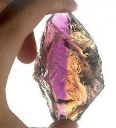 Ametrine from the Anahi Mine in Bolivia  Sometimes purple amethyst and yellow citrine are found in the same crystal. These bicolor gemstones are called ametrine. The Anahi Mine in Bolivia produces most of the world's ametrine.