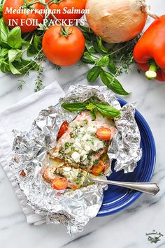 This 5-Ingredient Mediterranean Salmon is a healthy and easy dinner that everyone in the family will love! Plus, the foil packets make it great for camping!