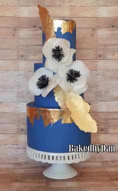 A Modern wedding cake with gold leaf, metallics and wafer paper anemones.