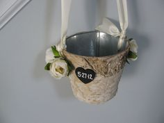 Rustic Flower Girl Basket Bucket with Birch Bark You choose colors and flowers Ivory ranunculus shown. $22.50, via Etsy.