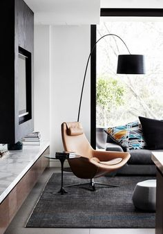 contemporary arch floor lamp living room interior leather armchair