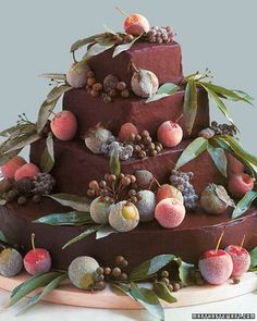 In this extravagant wedding cake, four tiers -- three squares atop a round base -- are covered in rich ganache and laden with sugar-coated fruit, chestnuts, and laurel leaves. The fruits and nuts should be applied with a generous hand, so that every guest gets his or her share when slices of the cake are passed around.