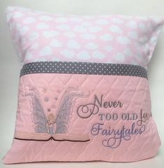 These adorable reading pillows would be the perfect gift for any woman or girl who loves to read! Available in both tree and fairy designs, the 16 inch square reading pillow is quilted and delicately machine embroidered in soft tones of blue and pink. The quilted pocket on the front
