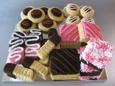 Hello, its a smorgasbord of crocheted treats! The platter includes pecan shortbread, raspberry jam shortbread thumbprints, chocolate-dipped pink shortbread cookies, chocolate-dipped shortbread fingers, snowball brownies, a peanut butter fudge brownie and strawberry and vanilla squares.  **This listing is for the PATTERN and not the finished items.  *Skill level Beginner *Prerequisite knowledge adjustable ring, working in the back ridge of a chain  *Yarn Any medium weight yarn! (Pictured)…