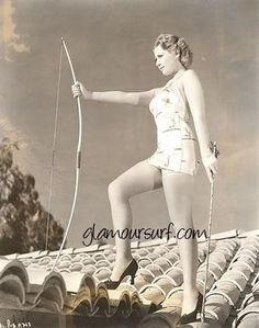 Archery in heels on top of a hard clay shingled house is glamourus ya know