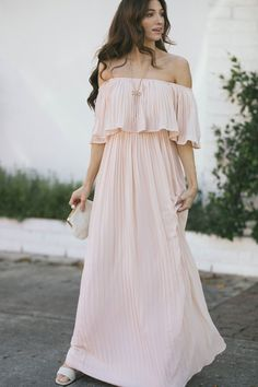 """The Sophia Pleated Maxi Dress is a gorgeous pick for your next formal occasion! Made in a dreamy off the shoulder silhouette with an elastic waist for the perfect fit. We love the mini pleats that add an elegant flare to this maxi! Perfect for any baby shower, photoshoot, or wedding - just add your favorite nude heels. SIZE INFO (Measured On Mannequin) Bust Waist Length Small 35"""" 25"""" 52"""" Medium 35.5"""" 26.5"""" 53"""" Large 36"""" 28.25"""" 54.5"""" FABRIC & CARE Self: 100% Polyester. Lining: 100% Polyester. Cute Maxi Dress, Maxi Wrap Dress, Cute Dresses, Beautiful Dresses, Dresses For Work, Wrap Dresses, Long Dresses, Flowy Bridesmaid Dresses, Maternity Dresses"""