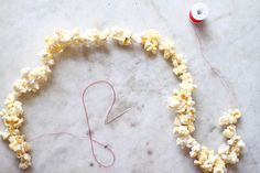 How to String Popcorn on a Christmas Tree.  The ultimate DIY decoration.